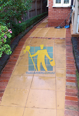 outdoor sandstone tiles pavers wet from cleaning with quarry tiles around Brighton